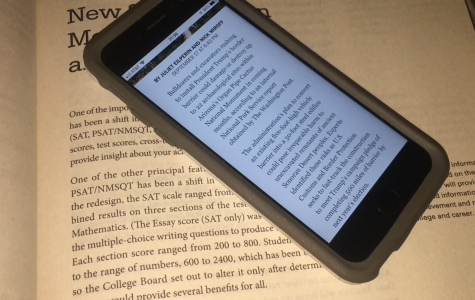 iPhone showing electronic text on top of classic paperback. Photo by David Seppelin