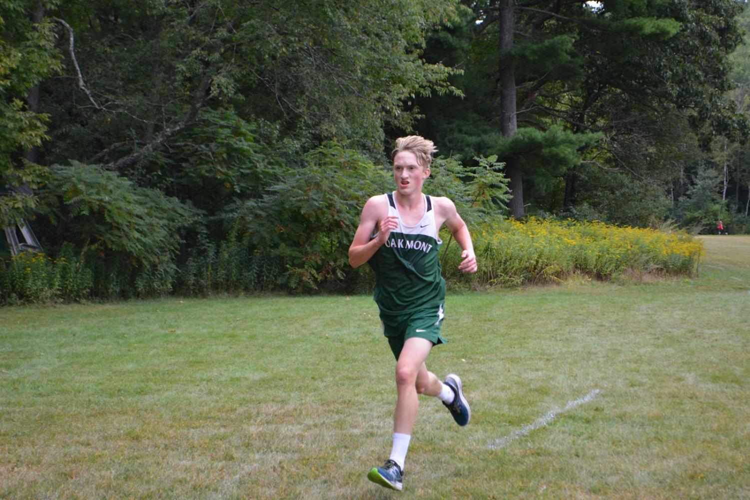 Marty Steucek running into the finish during September 10ths cross country meet against North Middlesex. Steucek finished 7th for the team with a time of 18:24. The cross country course was 2.8 miles.