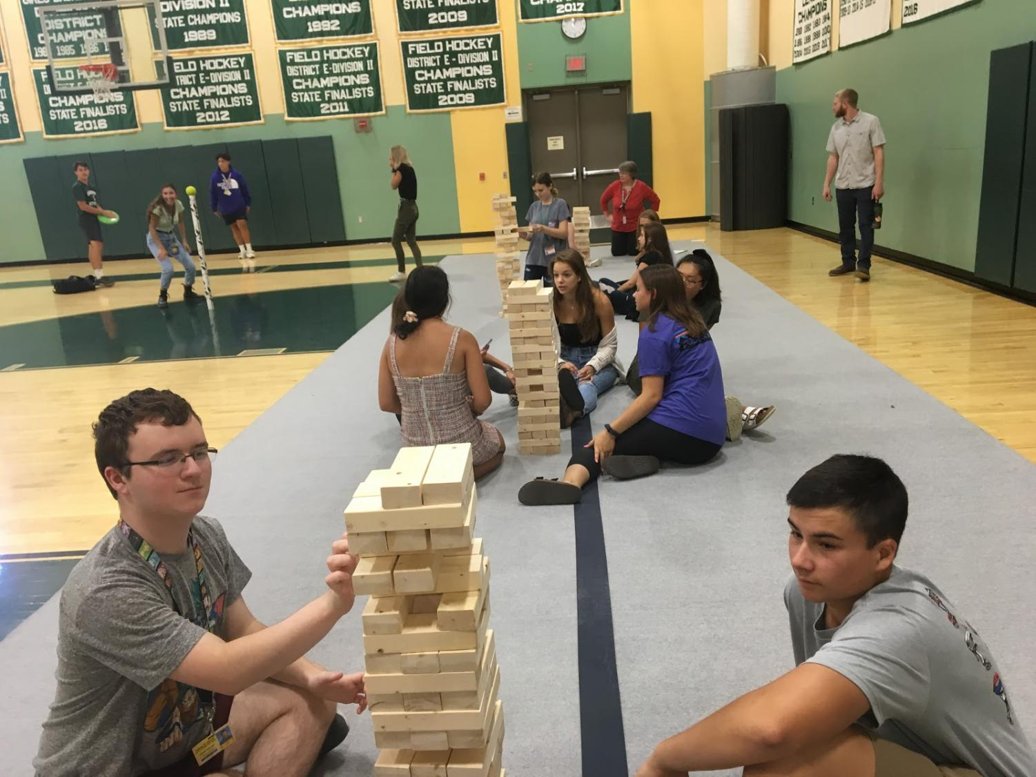 Oakmont students play Jenga in the gym on summer literacy day. Photo by Eric Rouleau