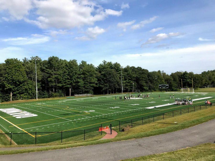 Football+team+practicing+on+new+turf