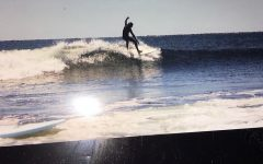 Patrick O'hara riding the waves at a competition in Narragansett, Rhode Island.