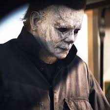 "Micheal Myers seen outside a gas station in the 2018 movie ""Halloween""."