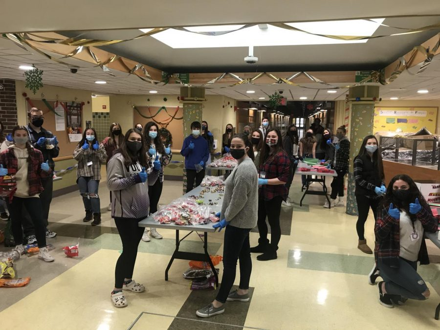 StuCo and Peer Leaders stuff donation bags to give to local schools