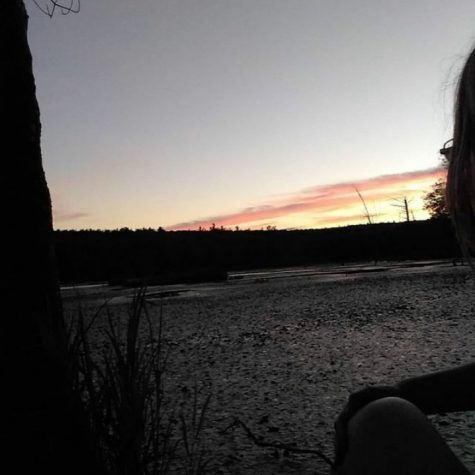 Dani Lewis watching the sunset for relaxation.