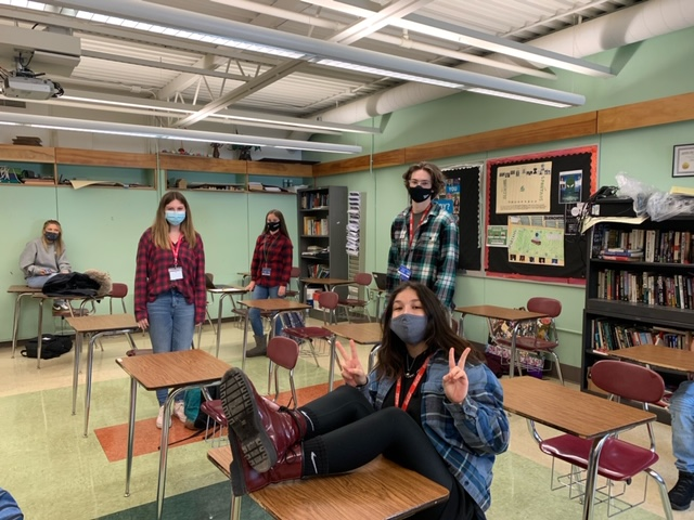 Four Oakmont students dress their best for flannel day.