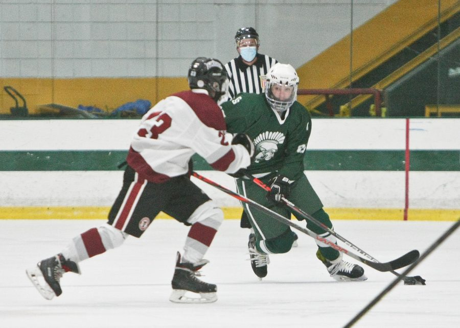 Kaleb Jakola takes the puck against Fitchburg.