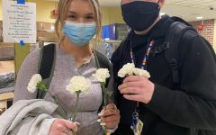 Principal Uminski gives all seniors St Patty's Day Carnations
