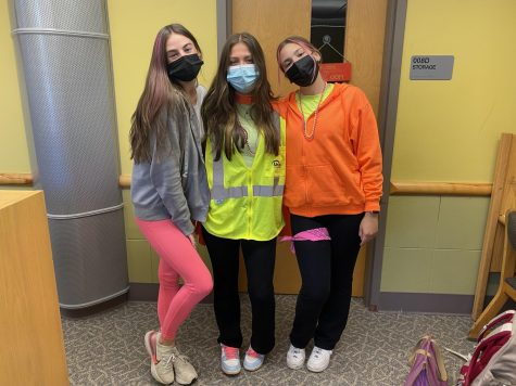 Students posed in the library with their neon spirit!