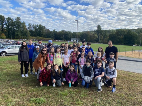 Ms. Denios 5th grade JR Briggs class and Mr. Nevards  9th grade pose after districts Walk to School